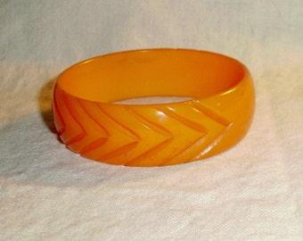 1930's Bakelite Pumpkin Color Slash Cut Bangle Bracelet