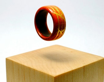 Pink ivory and gold wooden ring