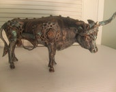 Put on reserve for  dear friends honey baby steampunk recycle  steer, bull, industrial art  assemblage on a sculpture