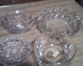 four vintage ashtrays