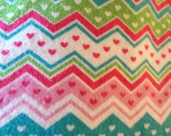 A chevron in pinks turquoise greens fitted crib /toddler sheet