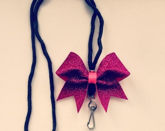 Mini glitter cheer bow lanyard.Ask about bulk discounts, color options.