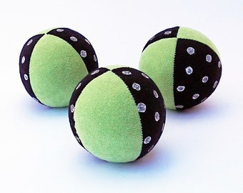 Set of 3 handmade, 2.5inch juggling balls with packaging and instructions in green&black with white polka dots