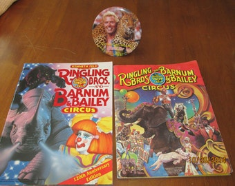 Ringling's Barnum and bailey circus programs and button from 1980 and 1990
