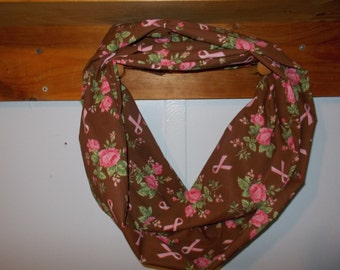 "Infinity Scarf. Brown with pink flowers and breast cancer ribbon.  Approx 5"" x 72"".  Great light weight scarf to add  to your outfit."