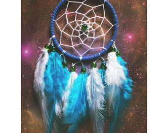 Blue dream catcher, faux suede, blue & white feathers, white web and green bead finish 7cm diameter dreamcatcher hand made