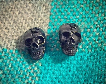 Black skull post earrings