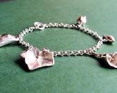 Sterling silver charm bracelet with leaf, lily, flower, bird pea pod, ivy, chunky sterling silver bracelet from UK