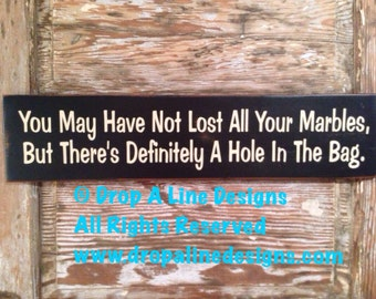 You May Have Not Lost All Your Marbles. But there's Definitely A Hole In The Bag. Funny wood Sign  5.5x24.