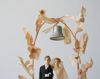 antique wedding cake topper: 1950's groom and bride with arch and bell