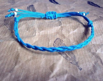 Waxed hemp cord adjustable plaited bracelet, finished with frosted, galvanised silver seed beads.
