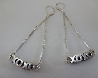 XOXO sterling silver earrings express yourself in silver caps swinging from silver bar chain linked triangles
