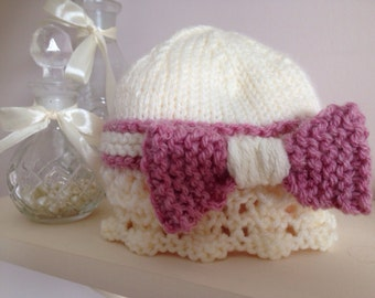 Hat with lace detail and oversized bow.