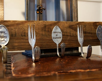 personalized wood spoon rack out of old silverware