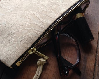 Handmade Vintage Fabric Clutch handbag with metal zipper made from repurposed upholstery fabric and cotton.