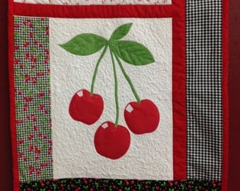 Cherries crib quilt - black and red