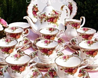 Royal Albert Old Country Roses tea set for 8 people with large teapot,large cake plate, 8 cups, saucers, plates a milk jug and sugar bowl