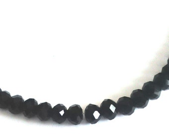 Black beaded necklace, 16 inches.