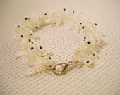 Bracelet in white-colourless decorated with smal leaves and flowers,  chic, elegant, party, romantic