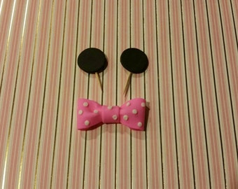 Set of 12 pink Minnie Mouse ears cupcake toppers with pink or red bow and white polka dots