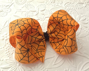 Halloween bow or headband: 4 inch bow in alligator clip or halloween headband for toddlers or infants. Orange bow, orange headband.