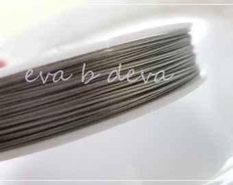1 small roll of .45  Tiger Tail Flexible Beading Wire 32 feet/10 meters