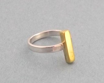 Golden rod on a silver ring