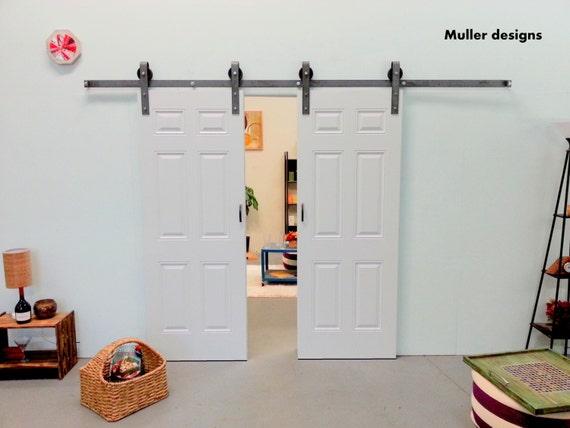 Double door sliding barn door hardware sliding by for Double hung sliding barn doors