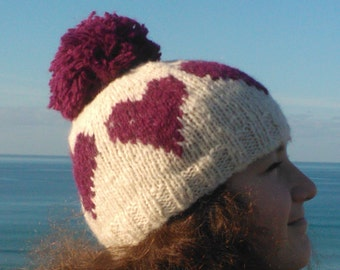 Knitting pattern for cowl, mittens and hat in aran alpaca with heart motifs