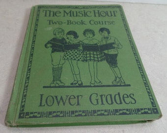 The Music Hour~  Two book course.  This is a California text book, by Osbourne McConathy.  1937 Hard back book.