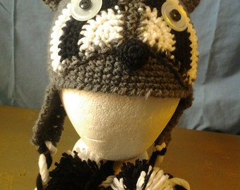 Racoon ear flap hat.