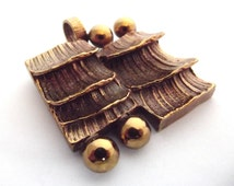 Vintage cast bronze Brutalist Scandinavian Modernist berry and shingle styled pendant. Made in Finland.