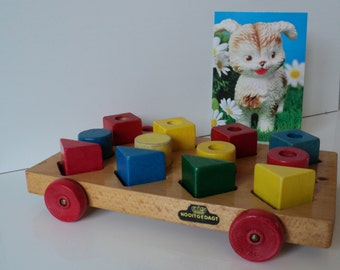 Vintage toy wooden cart with colourful blocks