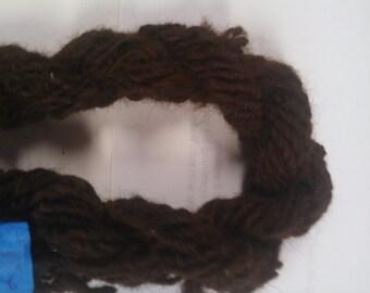 162 yards of 100% brown alpaca hand spun yarn.