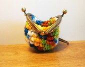 crochet coinpurse/keychain with ballclasp in multicoloured  yarn.