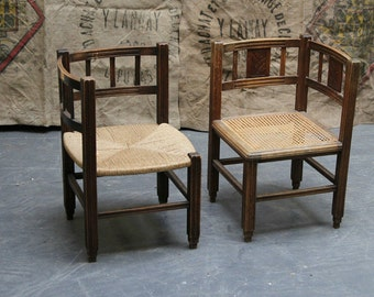 small carved wooden chairs