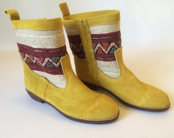 Handcrafted suede kilim booties.