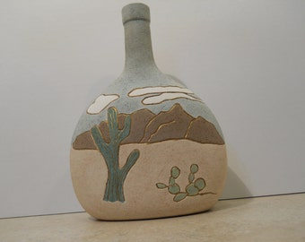 Southwestern Bottle decorated with a Desert scene.