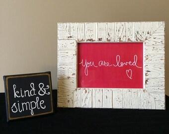 "Framed ""You are loved"" print"