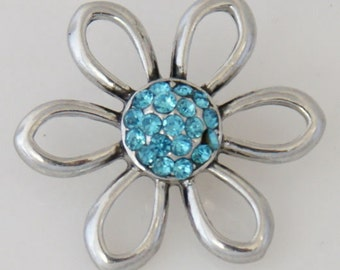 KB7732  Open Silver Flower Charm with an Aqua Crystal Center - 26mm wide