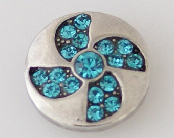 KB7882 Turquoise Crystal Pinwheel Set Off With a Silver Setting