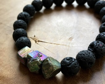 Rocky Road: an elastic beaded bracelet with a lava stones and Iron Pyrite in rainbow colors. Black and AB colors.