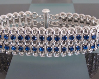 Women's Bracelet - silver chain, blue rhinestone and white leather. Magnetic clasp. 7 inches.