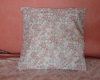Cushion cover with red, green and gold flakes