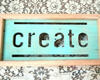 wood cut sign with frame: repurposed material