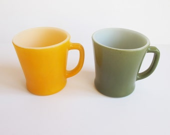 Two Anchor Hocking Fireking mugs. Made in the USA. Yellow and sage green.