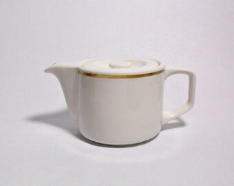 vintage Royal Doulton teapot.  2 cup fine hotel china, white with gold trim.  Perfect condition.