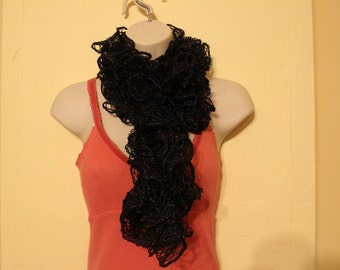 Black metallic knit ruffled sashay scarf