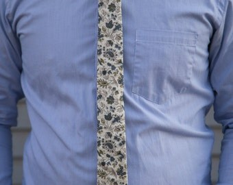 Off white with blue, green, and tan floral pattern skinny necktie