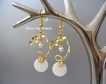 costume jewelry dangling earrings and white gold arabesques